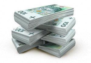 Pożyczenie pieniędzy w banku. Obrazek przedstawiający banknoty 100 zł.